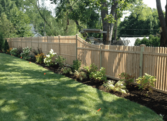 4 foot wood picket fence connected to 6 foot wood privacy fence with open top