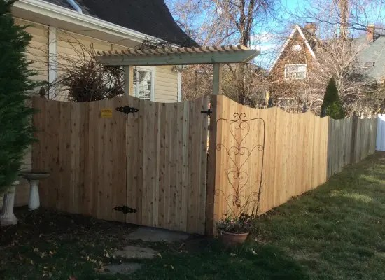 Solid wood fence with a concave top