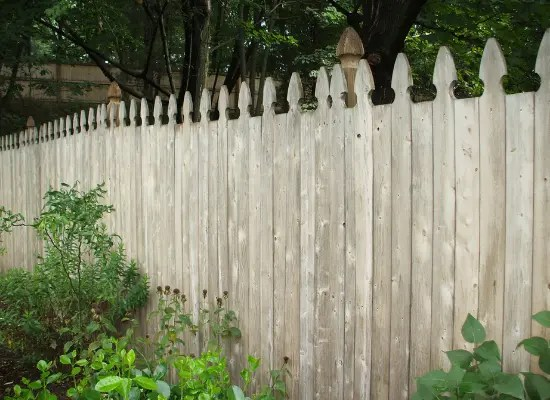 Dog ear solid wood picket fence