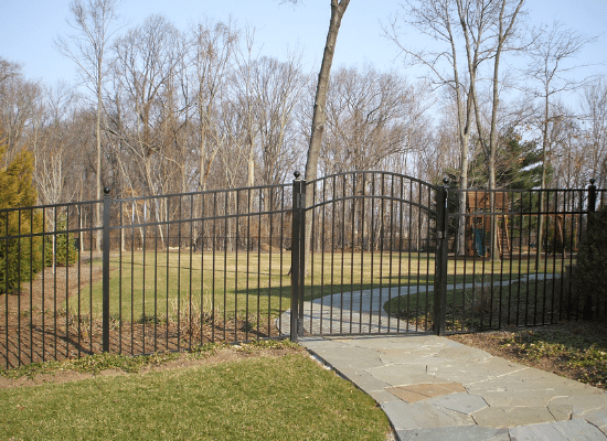 Black aluminum fence and gate single arch gate with a walkway