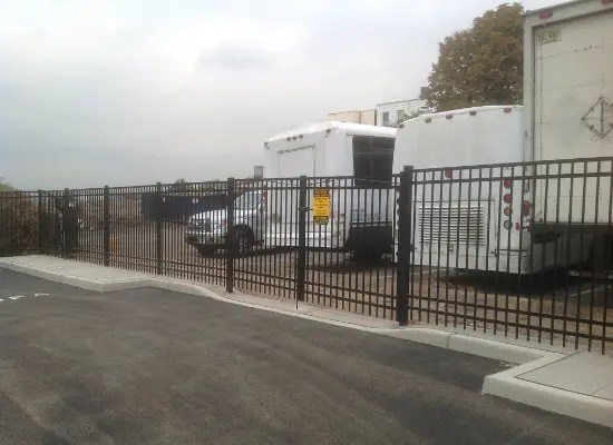 Black aluminum fence at a commercial property
