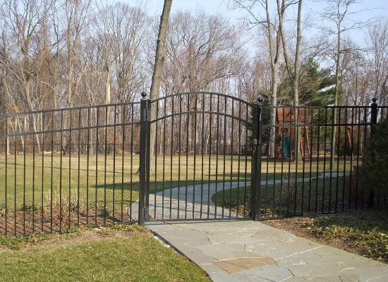 Black aluminum single arch gate on walkway