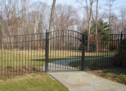 Black aluminum single arch gate on walkway