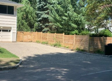 Front yard horizontal wood fence with spacing and gate