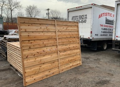 Section of horizontal wood fence constructed by Artistic Fence ready to be loaded into the Artistic Fence Trucks