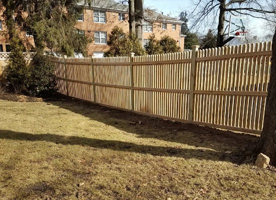 Wood fence style #300's with pickets and rails on both sides