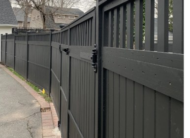 Black wood fence with closed top style and gate