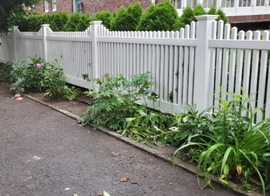White pvc fence with rails on both sides