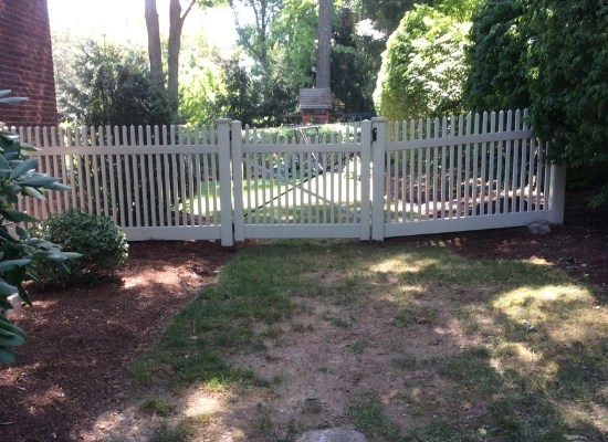 White vinyl picket fence with gate