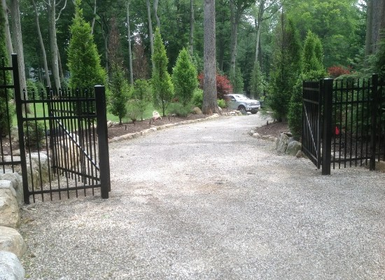 Black aluminum fence with double driveway gate