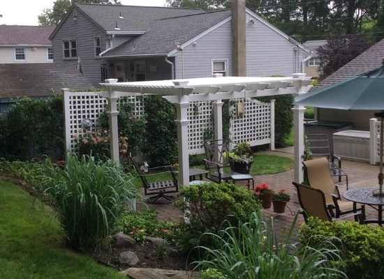 White pergola and lattice semi privacy fence in Bloomingdale, New Jersey