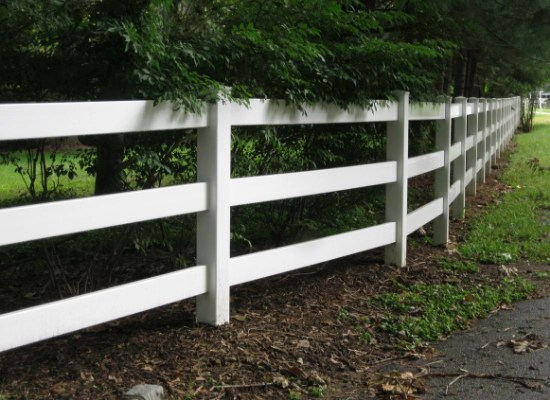 Three rail white split rail fence with flat rails