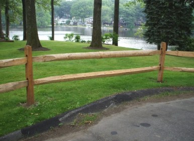 Two rail, rounded rail wood split rail fence in New Jersey installed by Artistic Fence Company