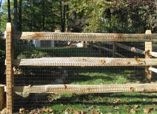 Three rail post and rail fence with wire installed in New Jersey