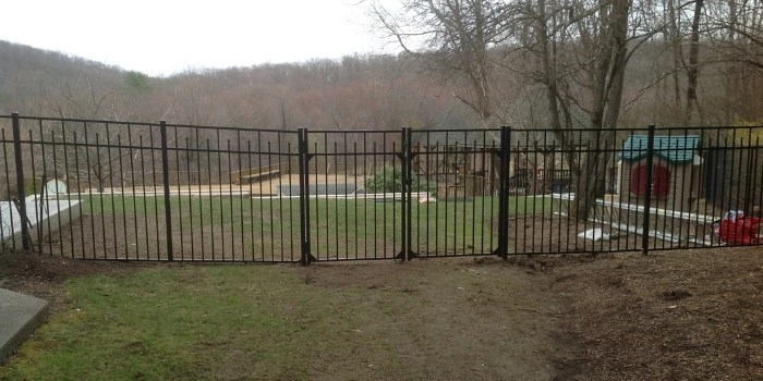 Black aluminum fence with a gate