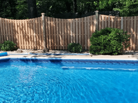 #121 Scalloped Board on Board pool fence in northern New Jersey