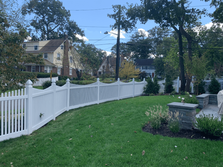 Nantucket Scalloped Vinyl picket fence with Gothic Caps