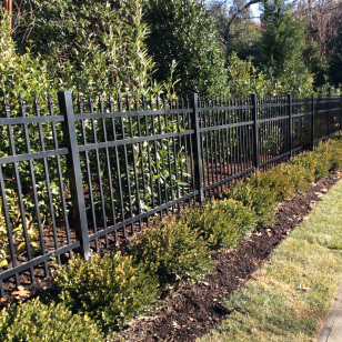 Traditional aluminum fence installed at a residential property by Artistic Fence Company