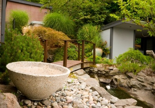 Backyard landscaping with rocks, planters, a bridge, and plants that are not exempt from New Jersey sales tax