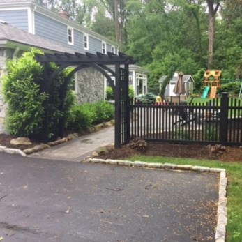 A permanent trellis and fence installed on a residential property in New Jersey by Artistic Fence company that required a ST-8 form