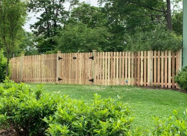 Style #104 wood picket fence with double walk date in Montclair, NJ
