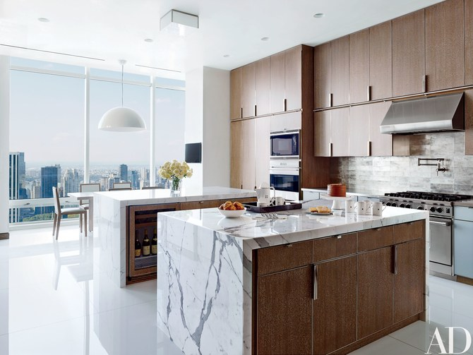 Kitchen with two matching calacatta marble islands
