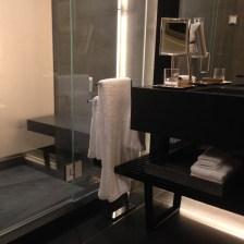 His bathroom black granite floor with tile shower