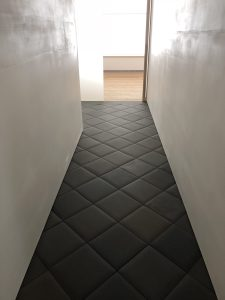 432 Park Ave hallway with custom pillowed tiles