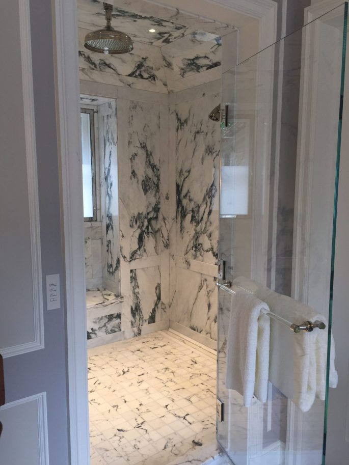 Master bathroom paneled shower window bench niche, floor, walls and ceiling in paonazzo white marble