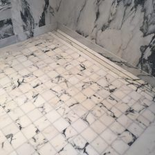 Shower floor and walls in paonazzo white marble