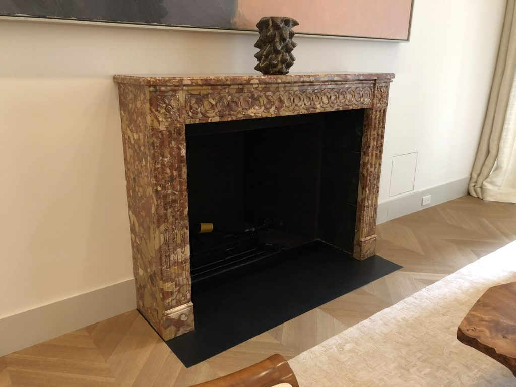 Antique breccia marble fireplace mantel