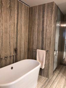 Master bathroom floor and walls in silver travertine slab
