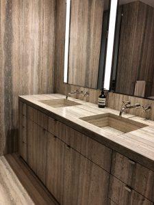 Master bathroom in silver travertine slab