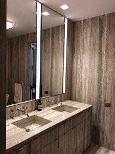 Master bathroom vanity, floor and walls in silver travertine slab