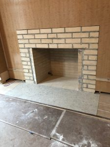Brick firebox is ready for a custom fireplace mantel