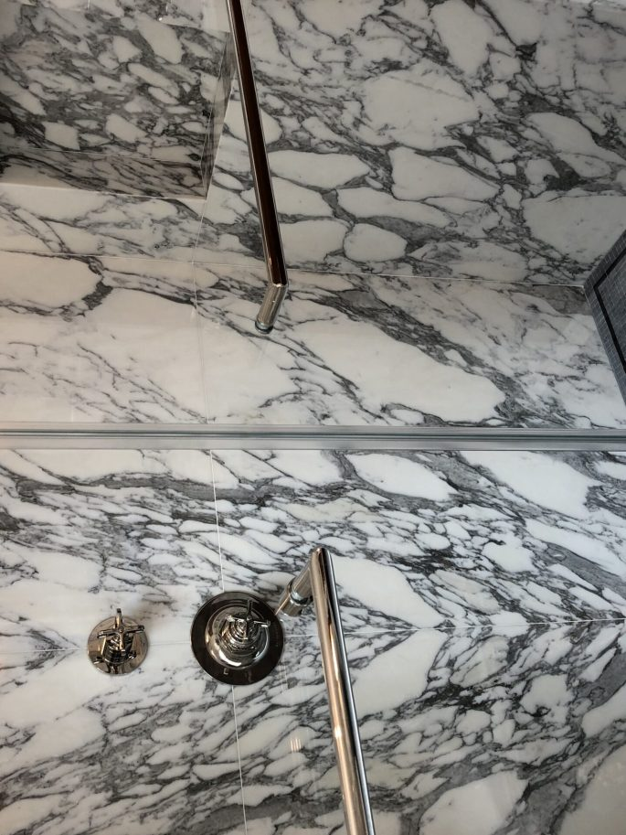 His bathroom shower in arabescato calacatta marble slab
