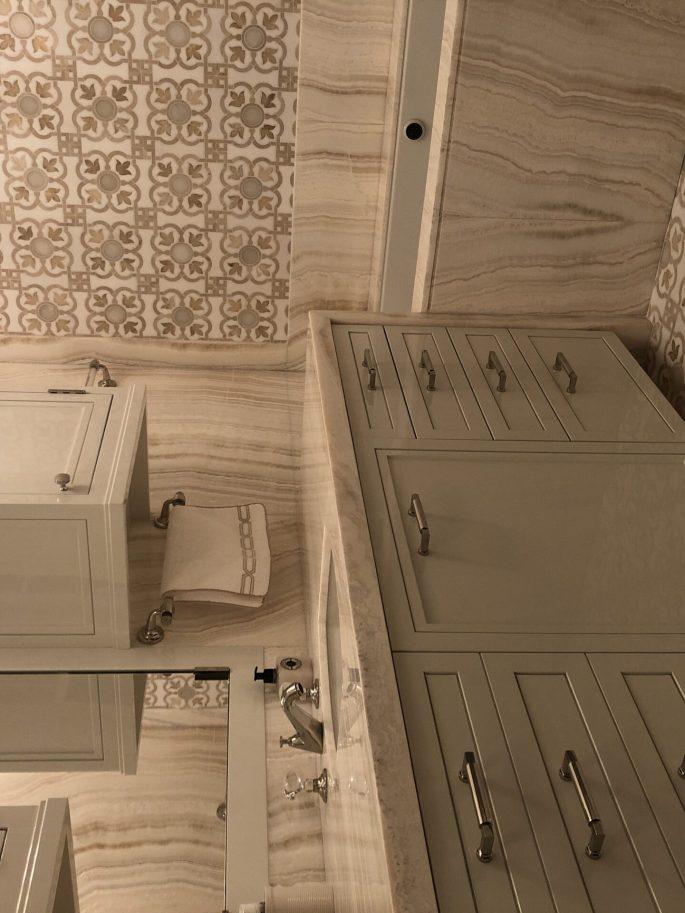 Her Bathroom in Ivory onyx slab and custom mosaic
