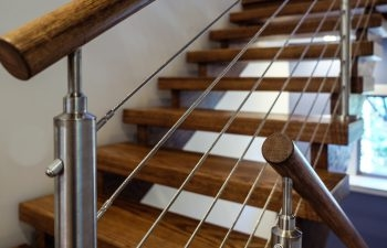 3 Popular Types Of Stair Railing Designs Southern Staircase   Wood And Wire Stair Railing   Hampton Style   Exterior   Closed Staircase   Horizontal Round Bar   Square Wire
