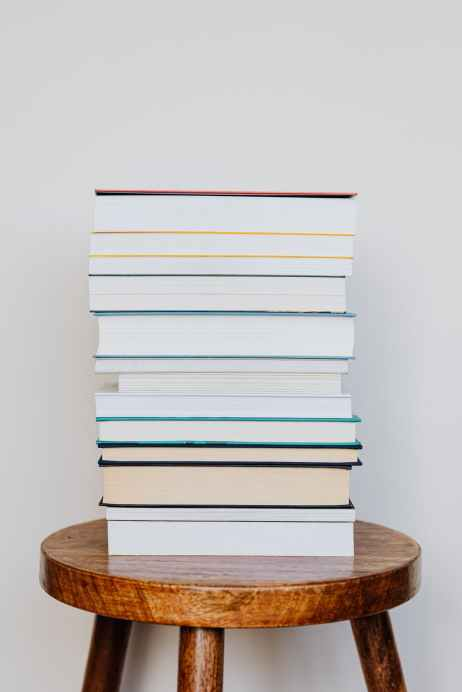 stack of books on wooden stool