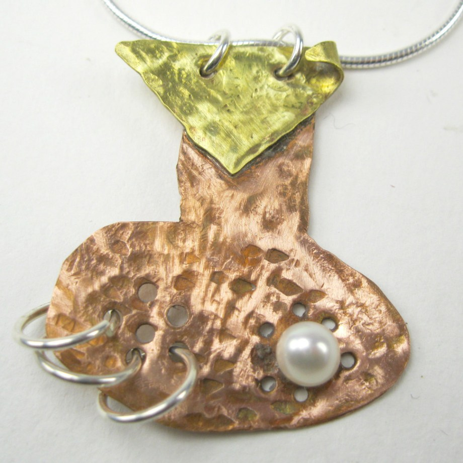 Title: Hang On Medium: Copper, Brass, Pearl & Silver Size: 2x3x.40