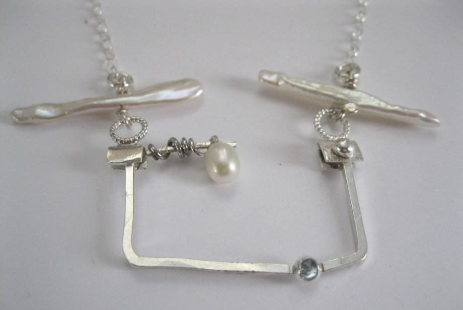 Title:Playful Medium: Silver, Pearl & Topaz Size: 2x2x.25