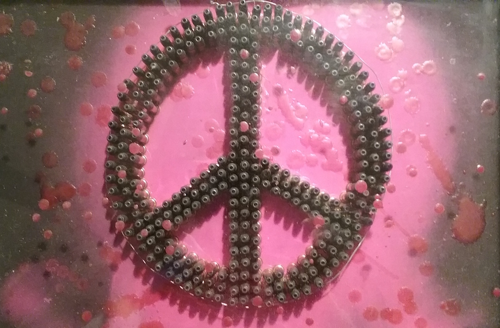"""Title: we must have Peace Medium: shadow box, wax, bullets Size: 11""""x14"""""""