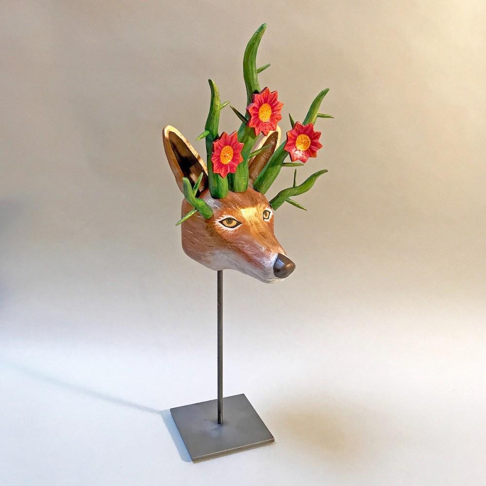"Desert Flower Coyote Medium carved fallen aspen, acrylic paint, wax, steel stand Size 19"" x 8"" x 5"""