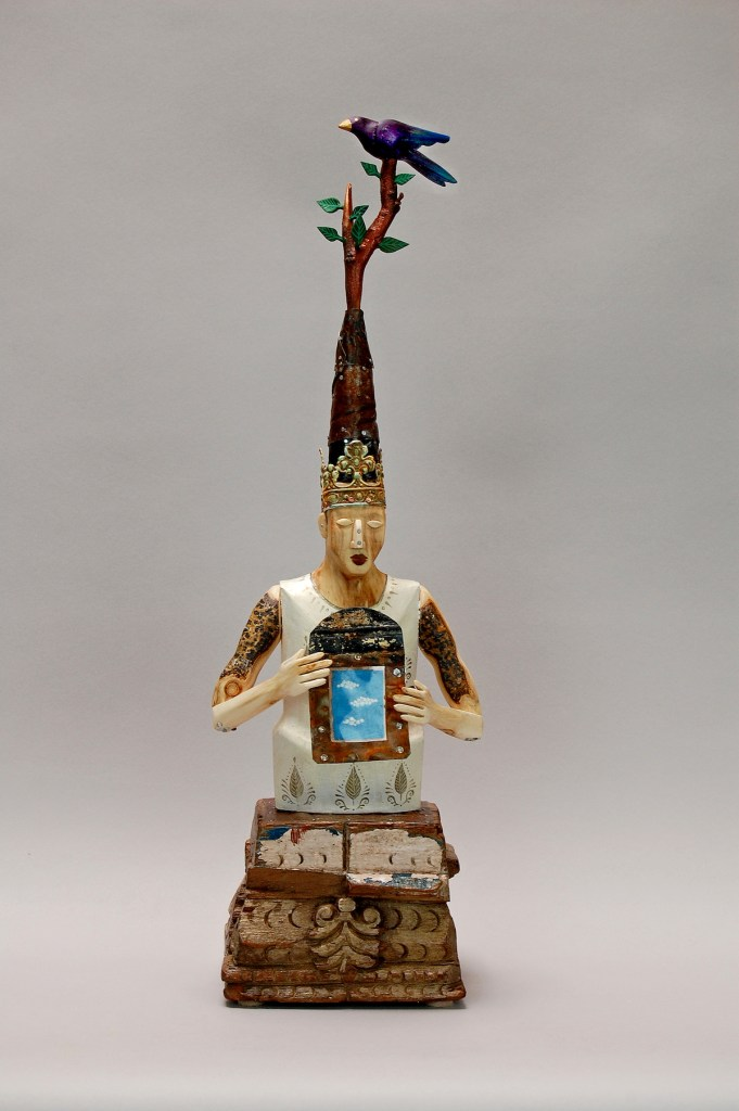 "Sky Prayer Medium carved fallen aspen, reclaimed wood, mica, amate paper, tin, acrylic paint, wax Size 18"" x 9"" x 5"""