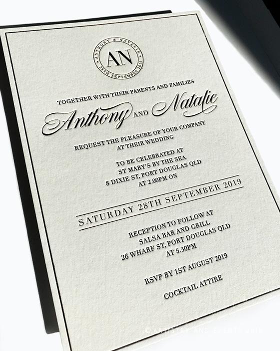 gold and letterpress wedding invitation
