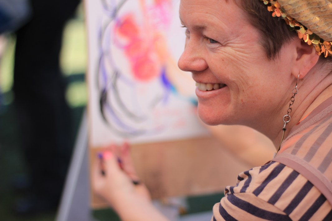 As part of her research, Sian gathered people's stories at Out in the Park, and in return gifted them her interpretive drawings of what they told. PHOTO: Tash Helasdottir-Cole