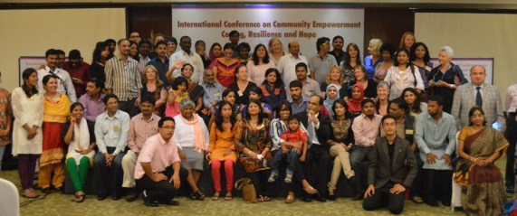 A group photo from the Strength's based practice conference
