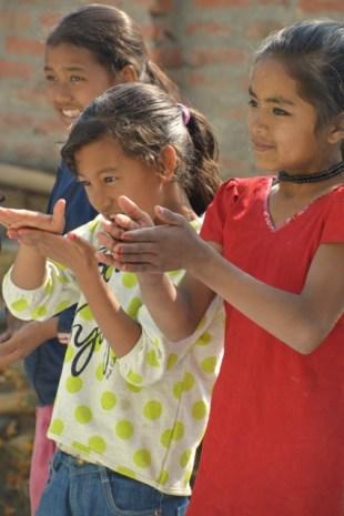 children miming hand washing