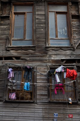 A boarded-up house with young children living in it, most likely a Syrian family, David Gross.