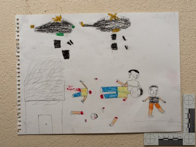 """""""Two planes drop bombs on the people. The children are crying, and the father has lost his hands."""" Drawing by Syrian girl."""
